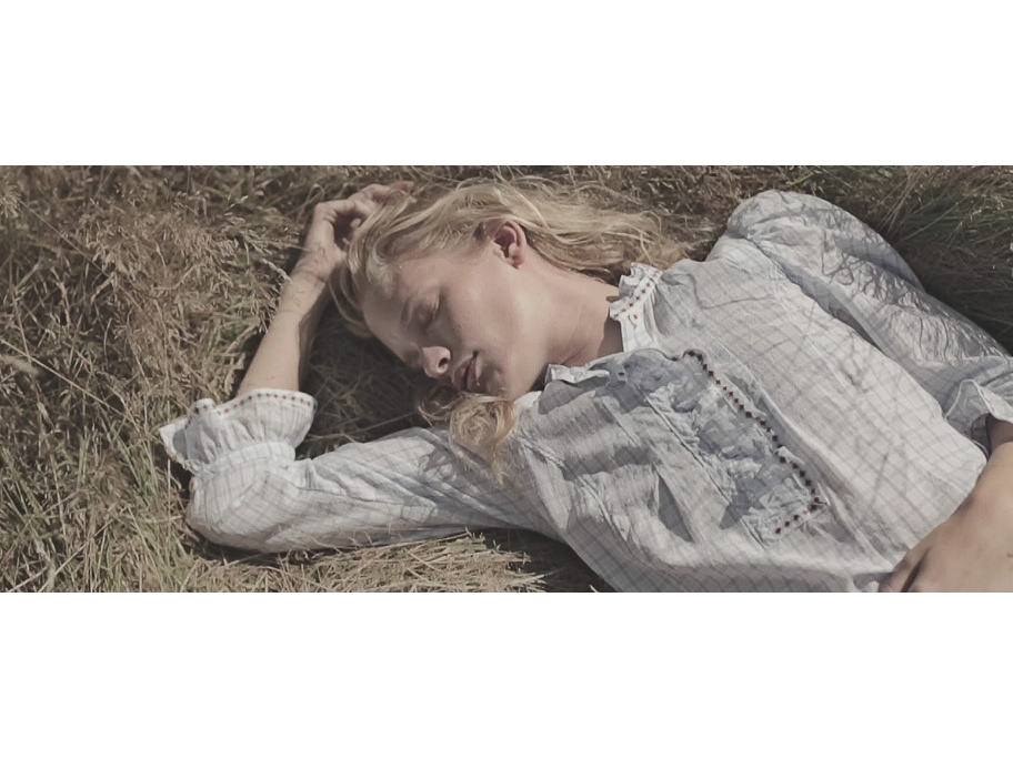 ILSE DE BOER SLEEPING ON THE GRASS